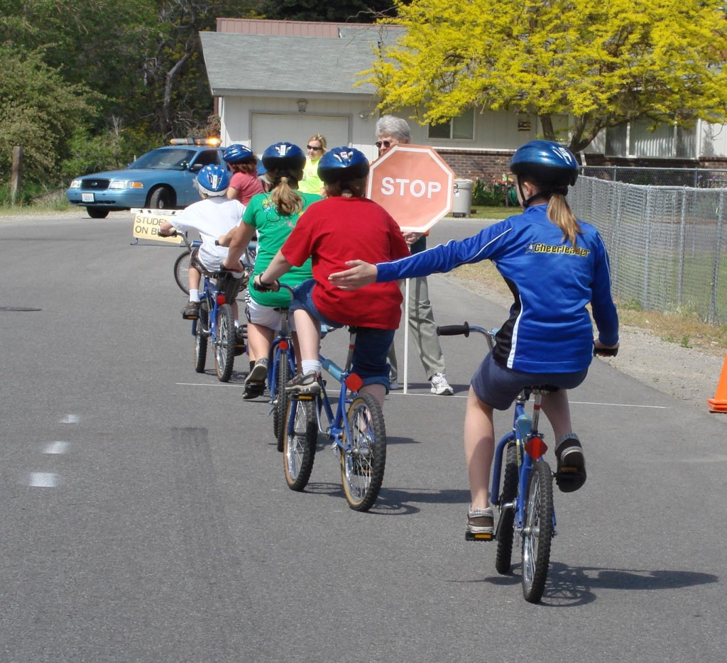 Children from Broadway Elementary in the Spokane Valley practicing our Safe Routes to School bicycle/pedestrian safety curriculum.