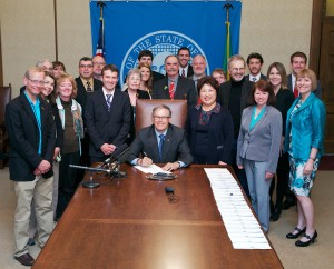 On May 16, 2013, supporters of better bicycling, walking, and neighborhood safety joined with Governor Inslee to sign the Neighborhood Safe Streets Bill into law