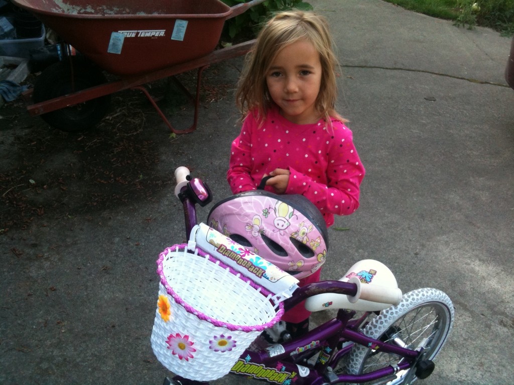 Stella with her bike and basket.