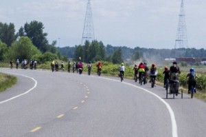 Riders along the shoulder of NW Lower River Road - a new trail connection will create a family-friendly connection to parks and wildlife opportunities