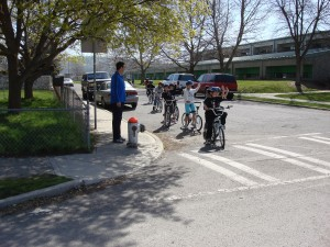 Kids on bikes learning safety skills.