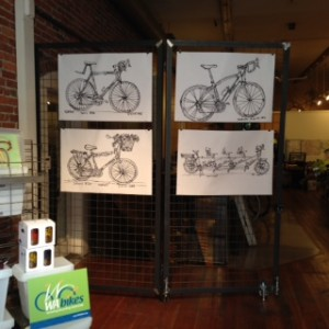 Photo of original bike sketches by Andy Goulding on display at Washington Bikes in Seattle's Pioneer Square for First Thursday May 1, 2014