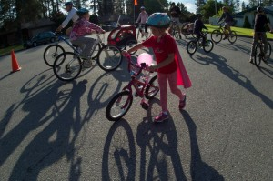 A young super-hero enjoys her time at Spokane Summer Parkways.