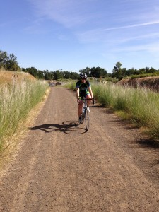 Here's Angie on her road bike bravely climbing a gravel hill.