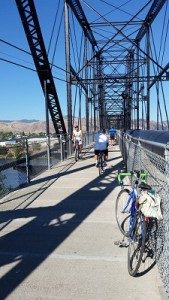 Bicycle riders on the bike/pedestrian bridge that connects East Wenatchee to Wenatchee at Pybus Market.