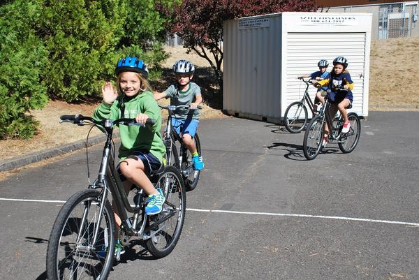 Children in White Salmon enjoying the bikes they got through the Safe Routes Bicycling/Walking Safety Education Program run by Washington Bikes with funding through the Dept. of Transportation. Photo  by Amber Marra, White Salmon Enterprise.