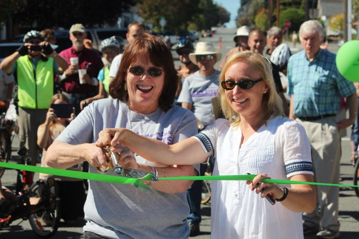 Anacortes Mayor Laurie Gere and WSDOT Sec. Lynn Peterson cut the ribbon in Anacortes for USBR10.