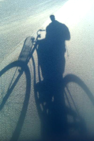 Shadow of a girl on a bike