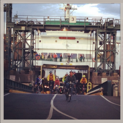 Cyclists offload at Colman Dock Ferry Terminal.