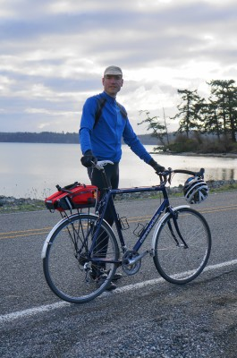 Brian Wood, student in UW master's in sustainable transportation, with his bicycle at Penn Cove, Island County, WA