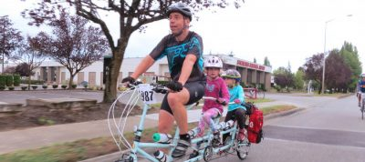 An everyday rider -- doing STP on a triple with his children.