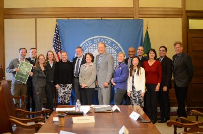 Representatives of outdoor recreation met with Gov. Inslee in November. L-r: Marc Berejka, Director Government and Community Affairs , REI; Jon Snyder, Policy Advisor to Gov. Inslee on Outdoor Recreation and Economic Development; Shiloh Schauer, Executive Director, Wenatchee Valley Chamber of Commerce; Katherine Hollis, Conservation and Advocacy Director, The Mountaineers; Julie Gregg, Director of Marketing and former WA Bikes board member, Sportworks NW; Jim Goldsmith, Board member, Washingtonians for Wildlife Conservation; Mary Dodsworth, Parks Director, City of Lakewood; Gov. Jay Inslee; Barb Chamberlain, Chief Strategic Officer, WA Bikes and Cascade Bicycle Club; Mike Schlafmann, Public Services Staff Officer, US Forest Service; Kendee Yamaguchi, Trade and Economic Development Director, Snohomish County; David Batker, Executive Director, Earth Economics; Kahty Young, President, Backcountry Horsemen; Glenn Nelson, Contributing Editor, High Country News and Trail Posse; Bob Whittaker, Founder, Ferry County Rail Trail Partners.