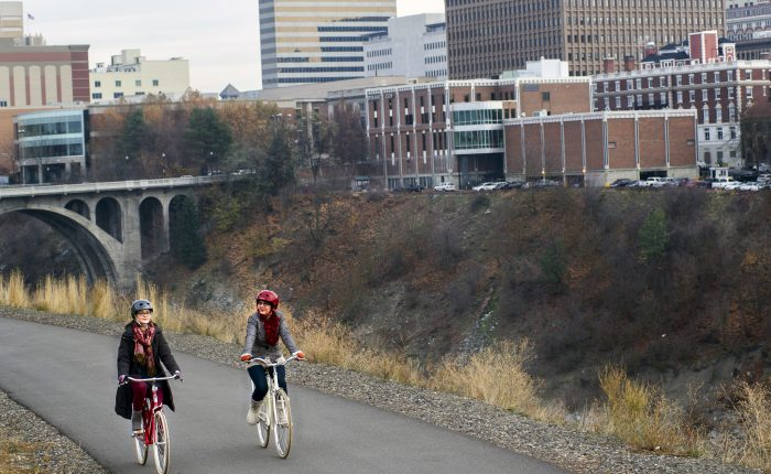 Lynn Ellis, left, and Patti Nepean, co-owners of MonkeyBoy Bicycles go for a ride on Tuesday, Nov. 18, 2014, at Kendall Yards in Spokane, Wash. TYLER TJOMSLAND tylert@spokesman.com