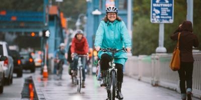 A woman rides across the Fremont Bridge