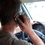 Federal agency calls for cell phone ban for drivers