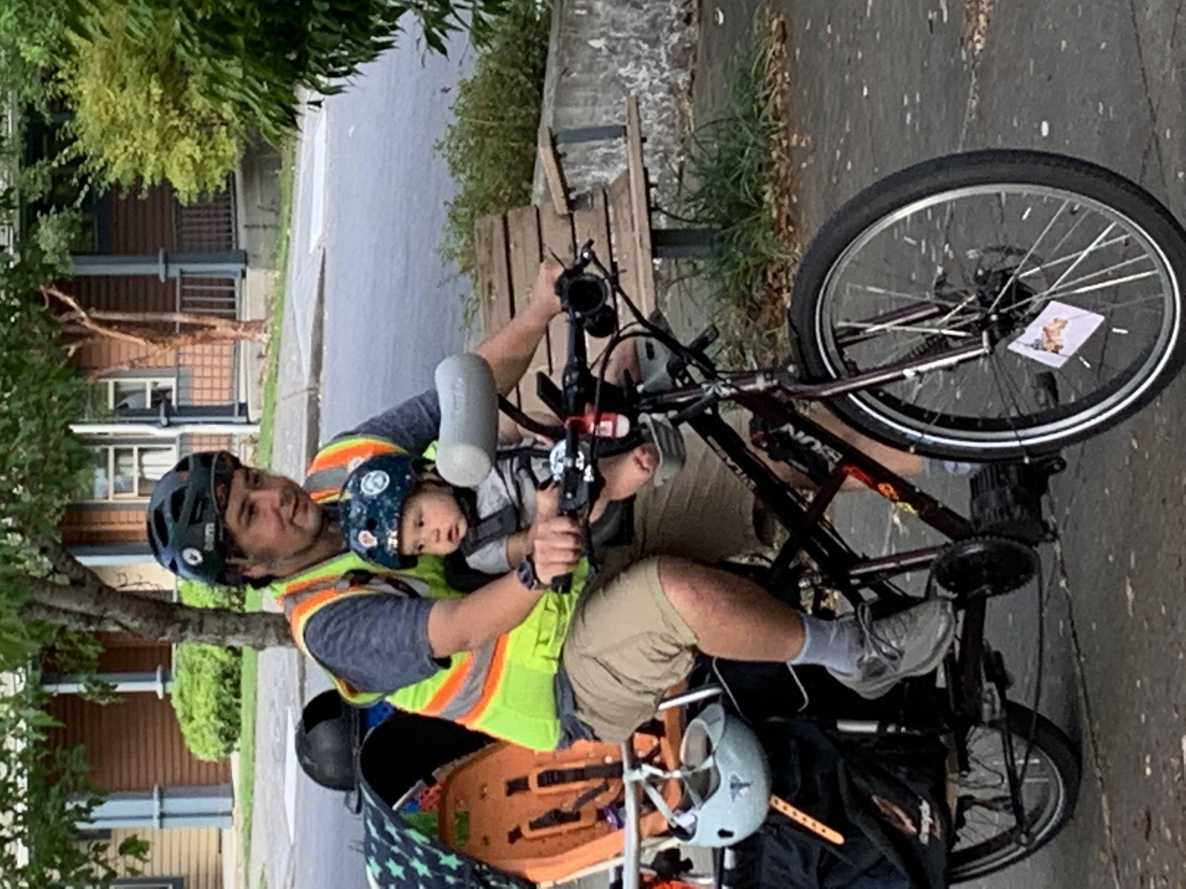 Sal Ponce rides with his daughter on his e-cargo bike